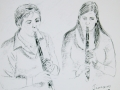 Mother & daughter playing the clarinet